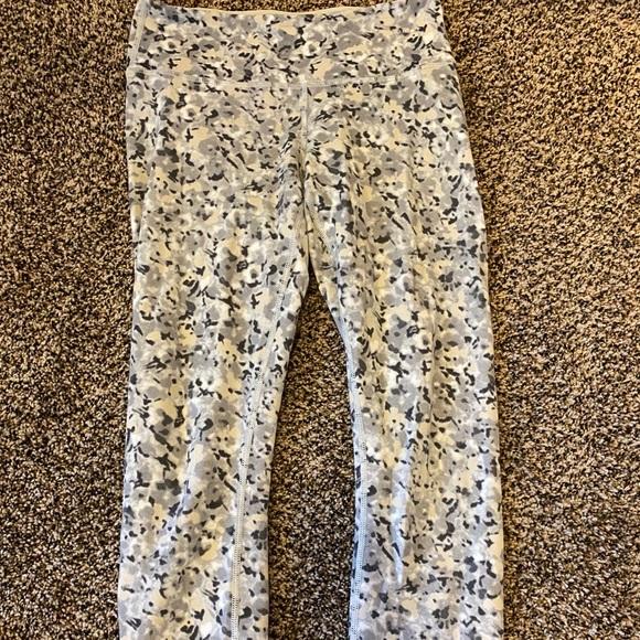 Black pair and flower patterned pair of leggings